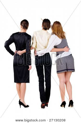 The back of three beautiful young business woman looking at wall. Rear view. Isolated over white.