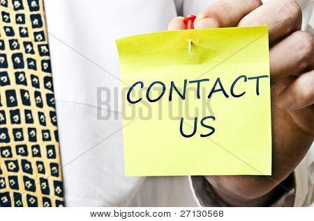 Contact us post it in business man hand