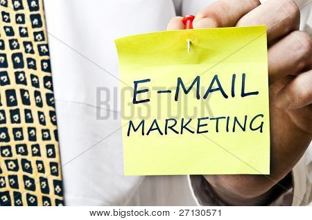 E-mail marketing post it in business man hand