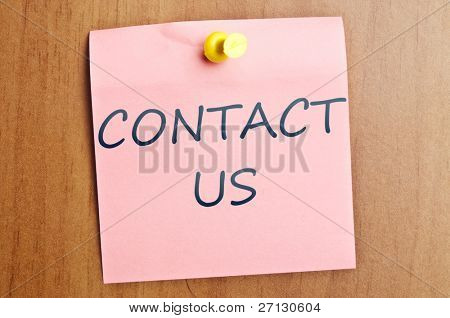 Contact us  post it on wooden wall