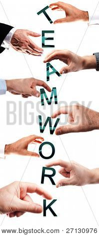 Teamwork word made by many business people hands