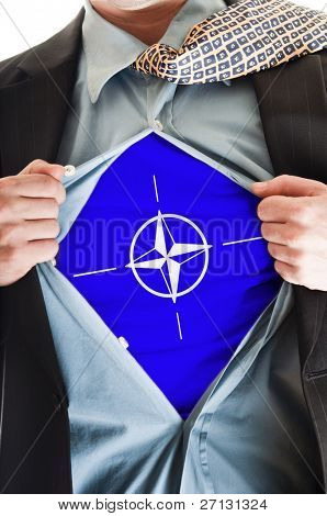 Business man showing  NATO flag shirt