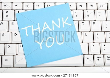 Thank you note on an white keyboard