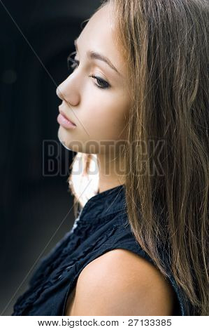 Closeup Portrait Of Gorgeous Young Brunette Girl.