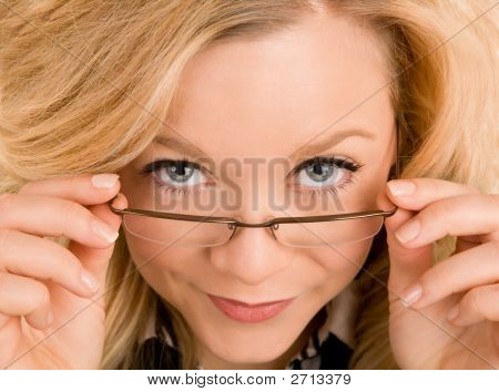 Beautiful Blonde Lady Looking Over Her Glasses