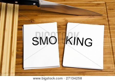 Knife cut paper with smoking word