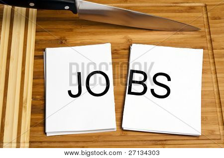 Knife cut paper with jobs word