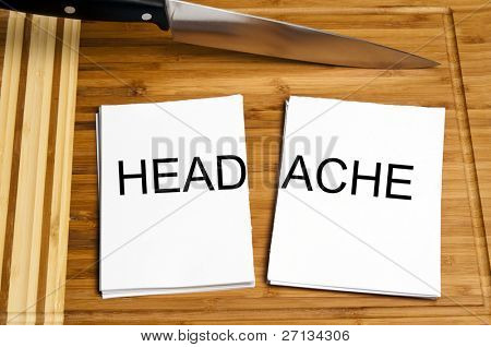 Knife cut paper with headache word