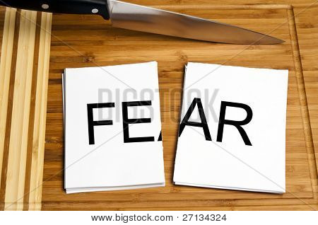 Knife cut paper with fear word