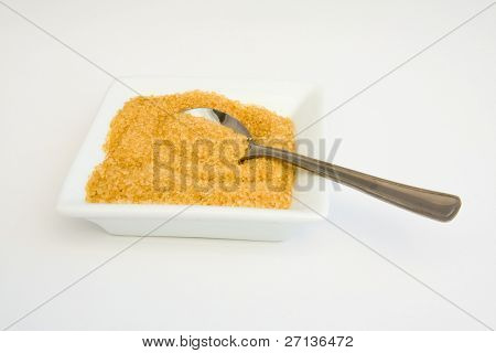 not refined brown sugar with a teaspoon
