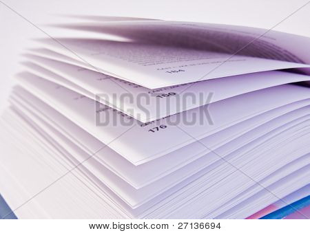a close-up of open book on white background