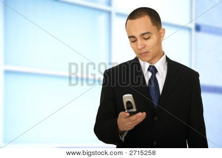 Business Man Texting In Office