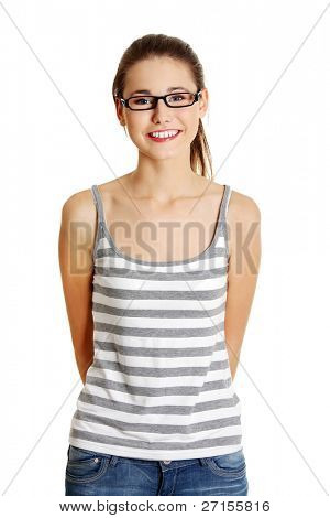 Front view portrait of a young female caucasian teen with glasses on her face smiling to the camera, on white.
