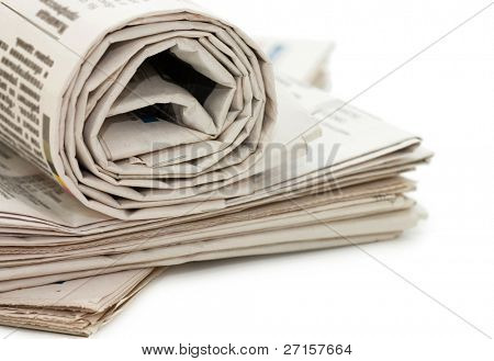 oll of newspapers, isolated on white background