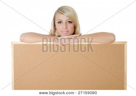 Portrait of woman holding a blank corkboard