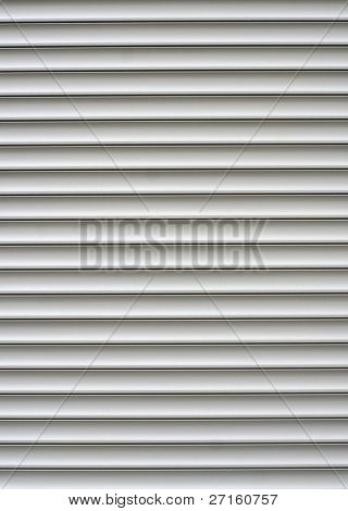 White shutters over a shop doors
