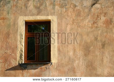 The only window in old painted wall