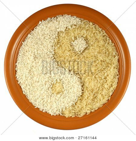 Plate of different kinds of rice forming Yin Yang symbol