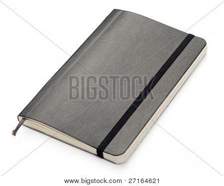 Black Moleskine notebook on white background