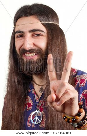 Friendly hippie with long hair making peace sign