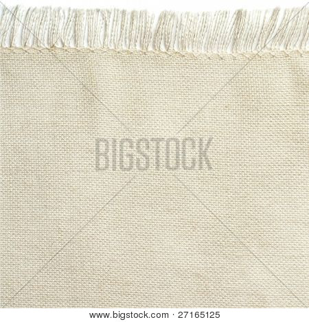Close up of a white cotton napkin isolated on white background