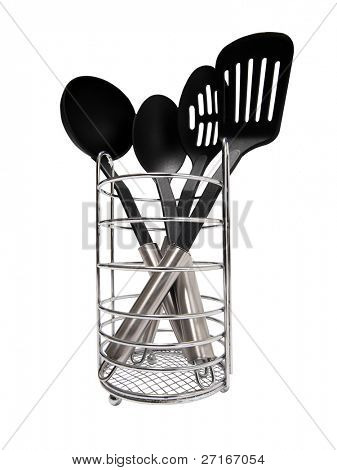 Kitchen utensils in a holder isolated on white background