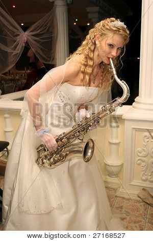 Bride plays the saxophone