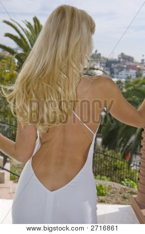 Woman In Backless Dress From Behind