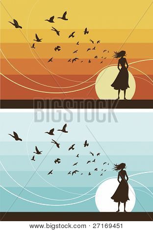 Girl stands in the wind, watching the sunset while a flock of birds take to the skies