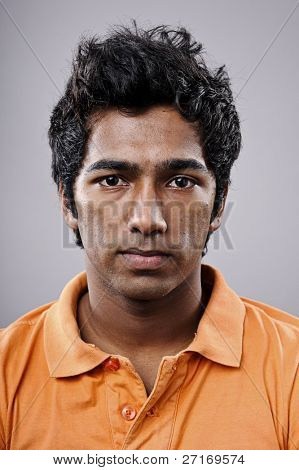 Young Indian man portrait in studio
