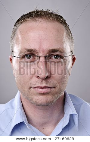 Fine art portrait of a young brunette man with glasses