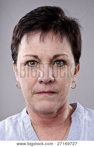 Brunette older woman portrait, high detail, wrinkles and blemishes