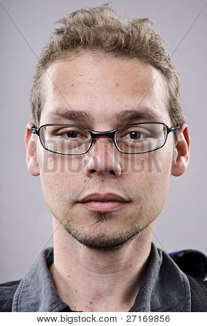 Skinny spectacles man portrait in studio