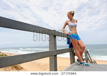 Young blond female rests along the pathway