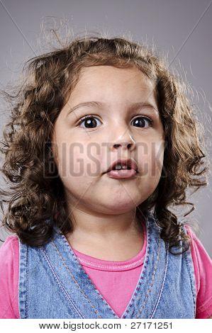 Portrait of a cute little girl in studio