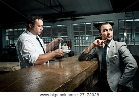 Businessman ponders as barista tops up his coffee mug
