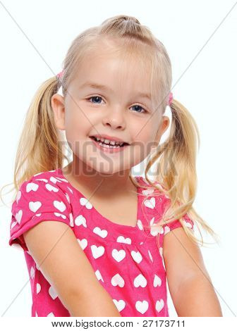 adorable blonde girl with pigtails smiles in studio, isolated on white