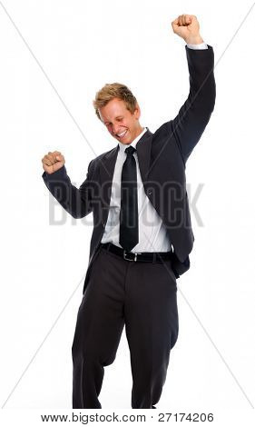 Young business associate punches his fist into the air in victory