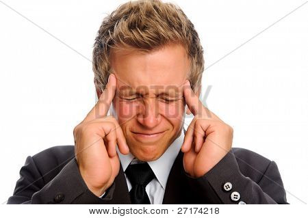 Attractive caucasian man in formal suit suffers from a migraine