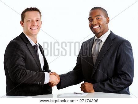 Happy businessmen shakes hands to seal the million dollar deal