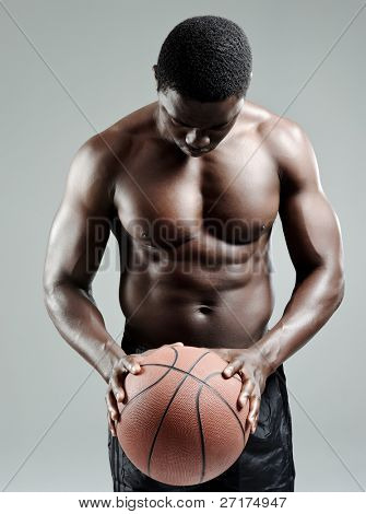 Toned African athlete taking a moment to prepare before a shot