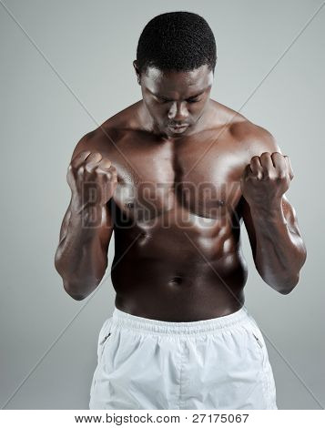 Well built muscular black man with clenched fists
