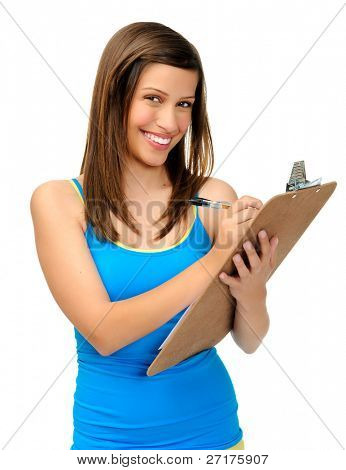 attractive young woman writes with a clipboard. researcher, survey or student taking notes.