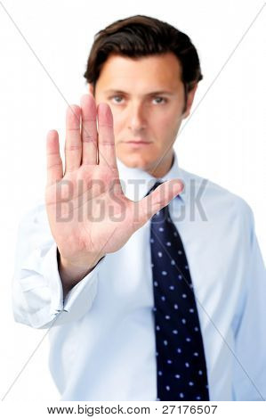 Businessman holding out his hand to show 'stop!'