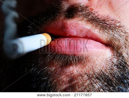 close-up of an unshaven smoker
