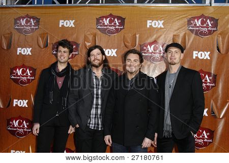 LOS ANGELES - DEC 5:Chris Thompson, James Young, Mike Eli and Jon Jones of the Eli Young Band arrives at the American Country Awards 2011 at MGM Grand Garden Arena on December 5, 2011 in Las Vegas, NV