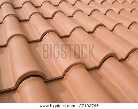 New orange roof tiles close up detail