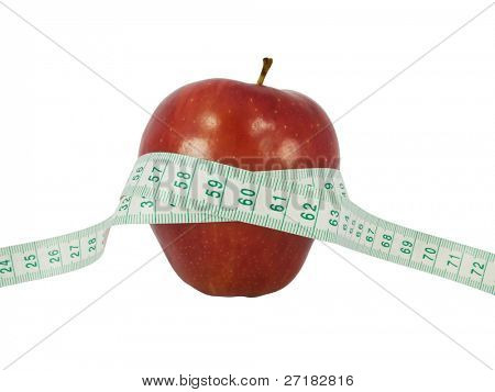 Diet concept with a red apple and a measure tape in centimeters (model waist measure length in tape)