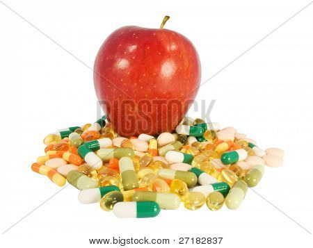 Red apple vs. food supplements in pills