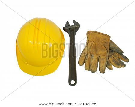 Yellow hardhat, old leather gloves and wrench isolated on white background